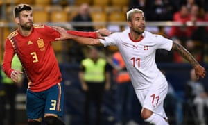 Valon Behrami, right, in action here against Spain, has played a big part in getting everyone pulling in the right direction.