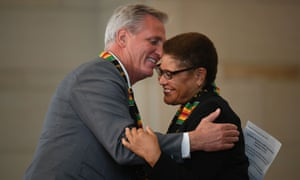 Kevin McCarthy hugs Bass during a ceremony to commemorate the 400th anniversary of the arrival of enslaved Africans in the US.