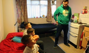 Glenn (no surname given) and his children who are living in an emergency hostel after becoming homeless