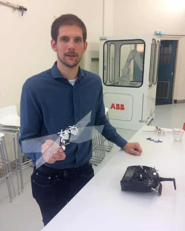 Matěj Karásek holds a DelFly robot.