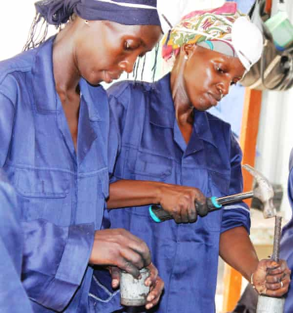 Njabe Ndaw, left, and Nyime Dibbo learn to make organic fuel briquettes at the Recycling Innovation Centre.