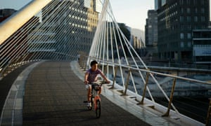 A boy cycles across the Zubizurri footbridge – newly installed with safety carpet.