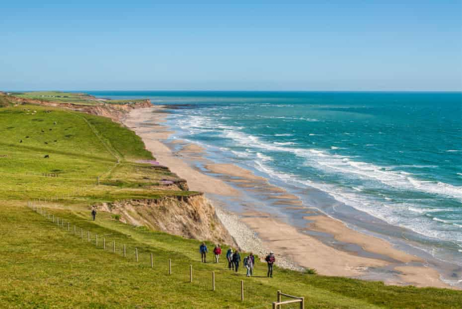 Group of hiker at a southern coastal walkway along the coastline of the Isle of Wight.