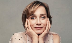 Kristin Scott Thomas looking at the camera and holding her head in her hands