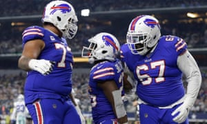 Buffalo Bills running back Devin Singletary (26) celebrates a touchdown with his teammates