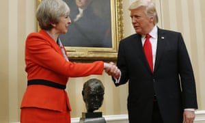 Donald Trump shakes hands with Theresa May in the Oval Office on 27 January.