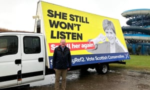The Scottish Conservative acting leader Jackson Carlaw launching his party's new campaign advert in Aberdeen. It is a poster criticising Nicola Sturgeon for wanting to rerun the 2014 independence referendum.