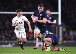 Magnus Bradbury of Scotland breaks with the ball for his team's third try.