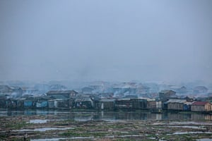 Lagos, Nigeria. Smog covers Makoko, a fishing community mostly made up of structures on stilts. Vehicle emissions, diesel generators, burning of biomass and garbage and other environmental waste greatly affect the community's water and air quality.