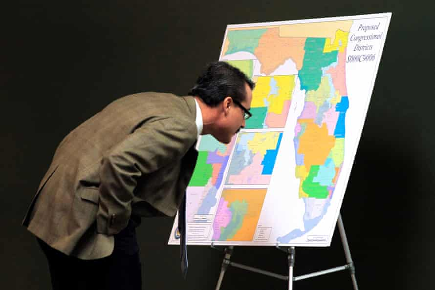 Florida state Sen. Rene Garcia looks at a map for proposed changes in congressional districts during a January 2012 state senate committee meeting.