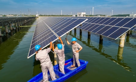 Workers at solar power station