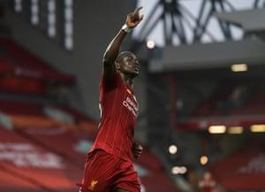 Sadio Mane celebrates after scoring Liverpooll's fourth goal.