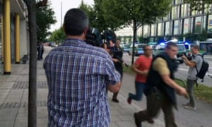Armed police responding to shooting at Munich shopping centre.