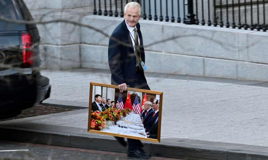 Peter Navarro leaves the White House with a photograph of Donald Trump and Xi Jinping, a week before the inauguration of Joe Biden.