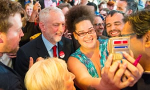 Jeremy Corbyn poses for a selfie after the launch of Labour's race and faith manifesto in Watford.