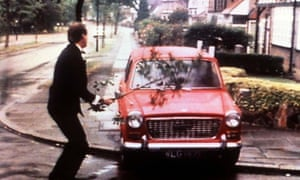 An enraged Basil Fawlty attacks his car with a branch.
