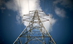 A pylon carries electricity from Wylfa nuclear power station, in north Wales.