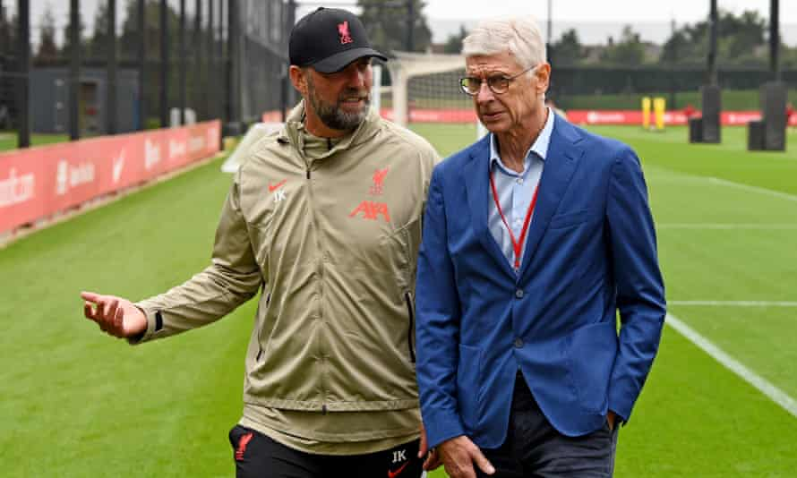 Jurgen Klopp with Arsène Wenger, Fifa's chief of global football development, at Liverpool's training ground in August 2021