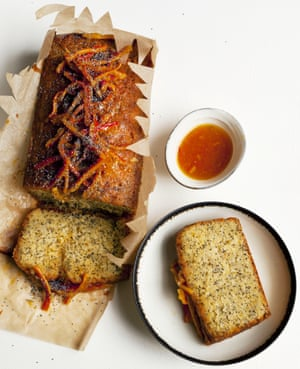 Nigel Slater's orange and poppy seed cake in opened parchment paper, with a slice on a plate and a dish of orange confit