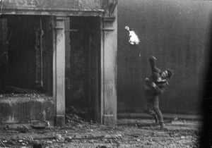 Man throwing a firebomb during the Battle of the Bogside, Derry, Northern Ireland, August 1969.