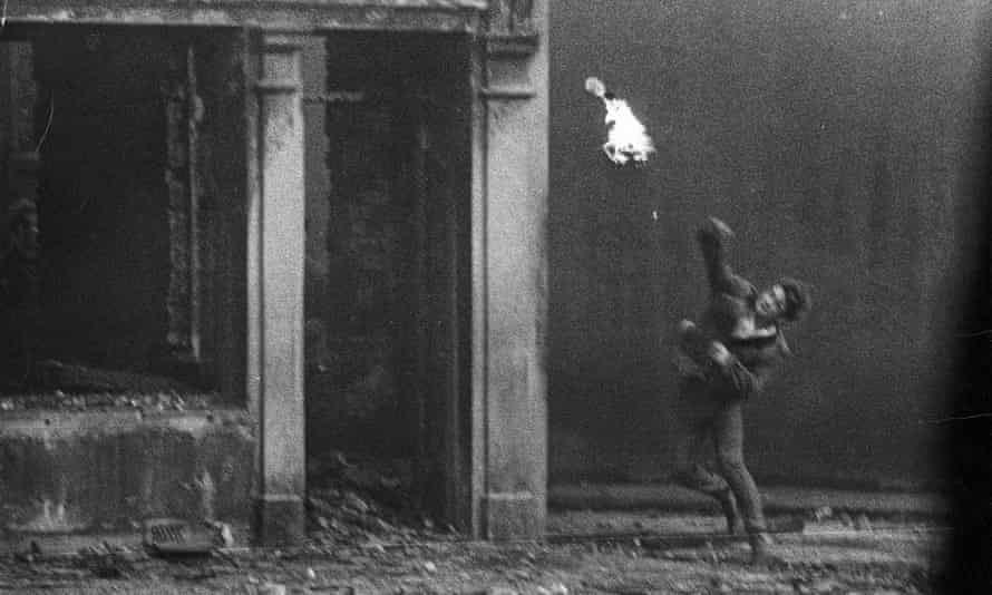 A petrol bomb being thrown during the battle of the Bogside in Derry, 1969. Photo: Tony McGrath/The Observer