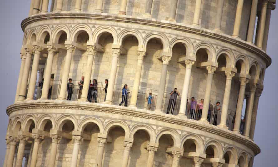 Tourists visit the leaning tower of Pisa