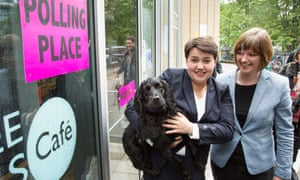 Scottish Conservative leader Ruth Davidson casting her vote along with partner Jennifer Wilson and their dog Wilson at Café Comino polling station, near the St James' Centre in Edinburgh