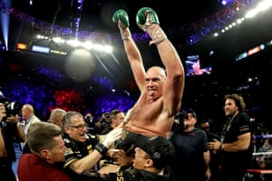 Tyson Fury celebrates his win by TKO in the seventh round against Deontay Wilder.