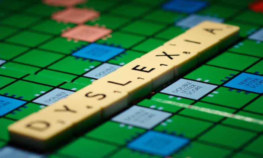 """The word """"dyslexia"""" laid out on a Scrabble board"""