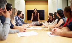 female leader at boardroom meeting
