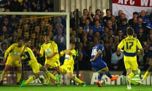 AFC Wimbledon's Tom Beere fires home his injury-time winner in the first leg of the League Two play-off semi-final.