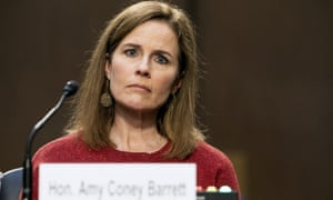 Amy Coney Barrett listens during a confirmation hearing.