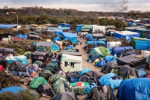 A wide shot of temporary shelters in the camp