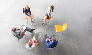 Academics in a circle with an empty chair