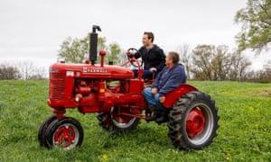Mark Zuckerberg riding a tractor