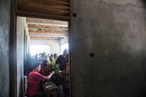 Hundreds gather at an abandoned building in Kiangwe village where Safari Doctors have set up their temporary clinic
