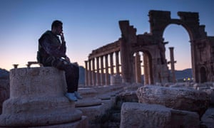 A syrian civil defence forces man sits on the the ruins the in Palmira, Syria, Sunday March 23, 2014. (Photo Sergey Ponomarev for The New York Times)