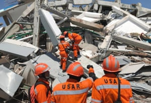 Indonesian rescuers work on the collapsed Roa Roa hotel as they try to find survivors.