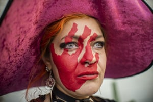Mexico City, Mexico. A woman with her face painted takes part in a protest against gender violence