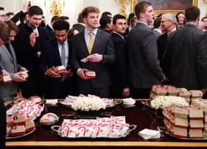 North Dakota players inspect the president's buffet choices