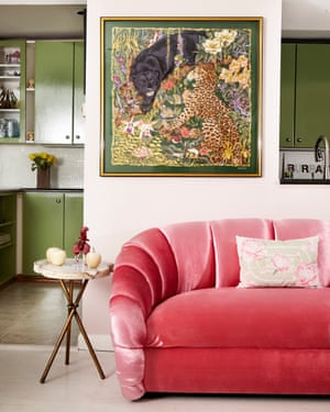 Animal magic: the kitchen, in Farrow & Ball's Breakfast Room Green and with an electric pink sofa.