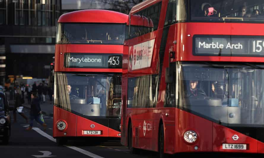 London buses on crowded streets.