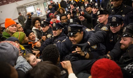 Police clash with demonstrators protesting the Staten Island, New York grand jury's decision not to indict a police officer involved in the chokehold death of Eric Garner in December 2014 in New York City.