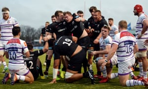 Saracens celebrate after Tom Woolstencroft crossed for their second try.