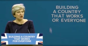 The letter F falls off the slogan behind May as she gives her closing speech at the party conference