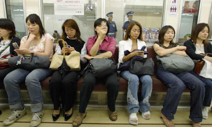 Women in a women-only carriage in Tokyo, Japan.