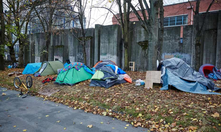 A homeless camp opposite a luxury hotel, near Piccadilly station in Manchester.
