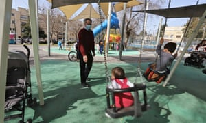 Yoel Silver pushes his granddaughter on a swing