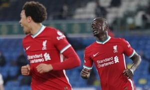 Sadio Mane celebrates scoring their first goal with Trent Alexander-Arnold.
