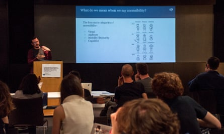 A member of the Guardian Accessibility Working group stands at a lectern, presenting a slide deck. The screen shows a diagram demonstrating the types of Accessibility requirements